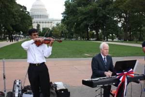 Daryl Gilbert and musicians led the celebration in a stirring rendition of God Bless America